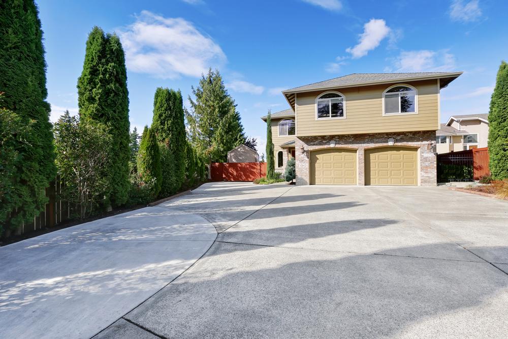 Should You Fix Your Concrete Driveway or Pour Asphalt?